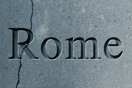 etch: Engraving spelling the city Rome on textured old surface Stock Photo
