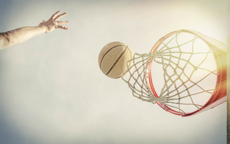 Basketball layup shot scene from just below the net Stock Photo