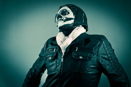 cocky: Egocentric aviator with face painted as human skull Stock Photo