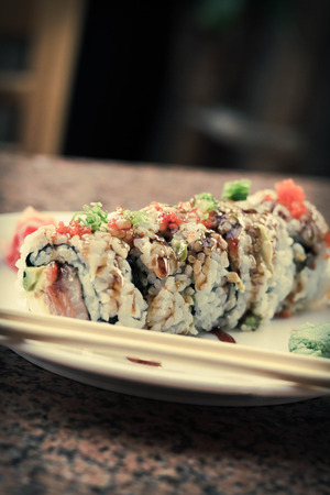 philadelphia roll: Fancy Philadelphia sushi roll topped with roe sushi sauce and chopped scallions