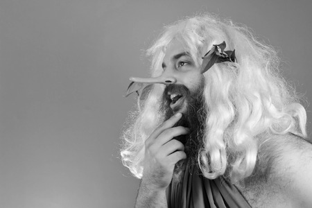 trickster: God stroking beard and telling many lies as his nose grows