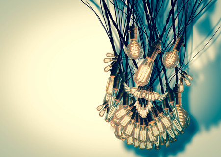 bearded wires: Smiling anthropomorphic face made from hanging edison light bulbs Stock Photo
