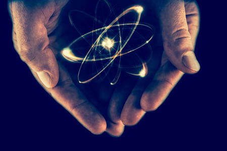 quarks: Atomic orbitting particle being held in cupped hands