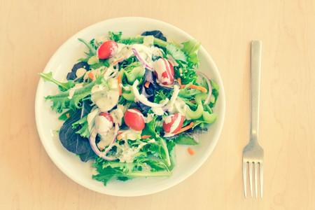 Fresh organic garden salad with creamy ranch dressing Stock Photo
