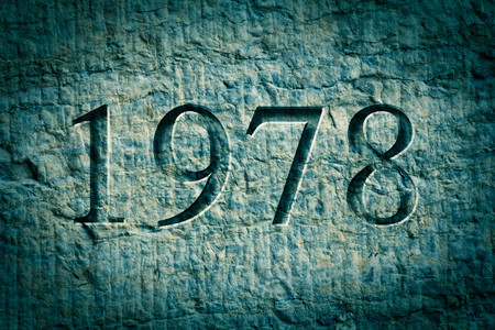 chiseled: Historical year engraving 1978 on textured old surface