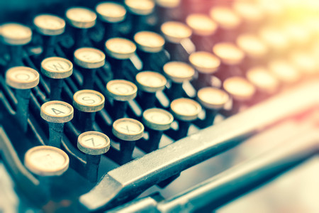 Old vintage typewriter keys in this retro creative writing and relaxation themed desk top Stock Photo
