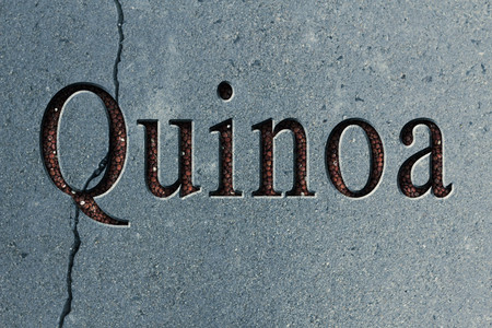 Text engraving word quinoa with quinoa grains filling up the engraving Reklamní fotografie