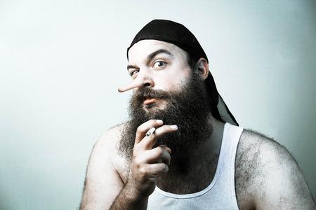 panache: Intimidating redneck smokes cigarette as his liar nose grows