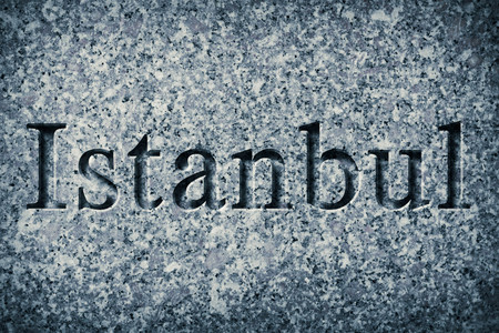 Engraving spelling the city Istanbul on textured old surface