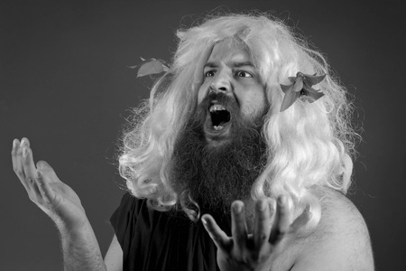 Pleading zeus god or jupiter throws his hands in the air Stock Photo