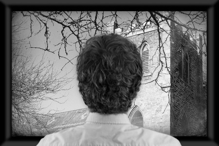 flat screen television: Back of mans head as hes watching flat screen television