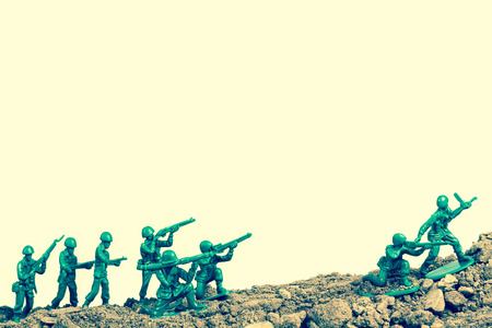 green military miniature: Toy soldiers march along the horizon in war image Stock Photo