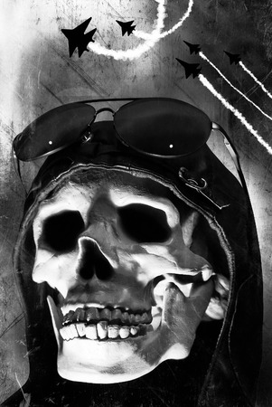 Spooky dead aviator skull with fighter jets in the background Stock Photo
