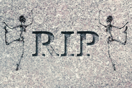 symbols of peace: Engraved headstone spelling the letters RIP with Skeletons - rest in peace