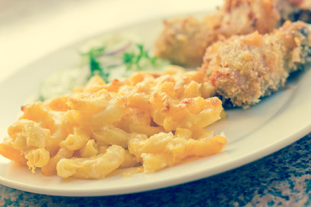 fried chicken: Country fried chicken with home made macaroni and cheese with cucumbers
