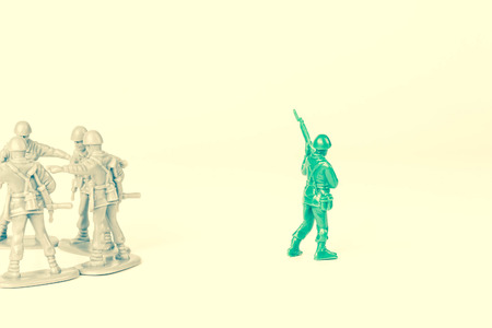 peer pressure: Gray toy soldiers excluding the green toy soldier
