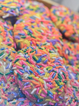 jimmies: Background of colorful bakery fresh sugar cookies with sprinkles