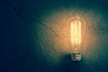 antique: Decorative antique edison style filament light bulb Stock Photo