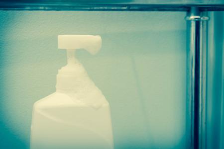 suds: Liquid soap moisturizer dispenser with fun lathered soap suds Stock Photo