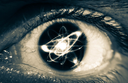 Atomic particle reflection in the pupil of an eye for physics background Stock Photo