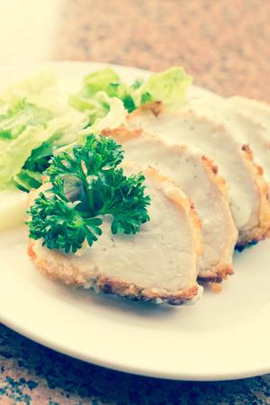 bleu: Sliced chicken cordon bleu with creamy sauce and romane leaf salad Stock Photo