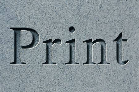 Engraving spelling the word Print on textured old surface