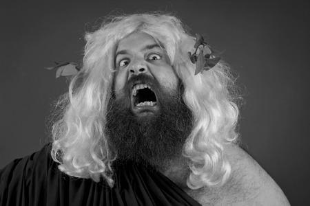 wrath: Angry screaming wrath of god against orange background Stock Photo