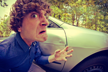 swerve: Silly man gets into car crash and makes ridiculous face