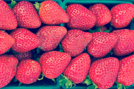 and organic: Bunches of organic strawberries at local farmers market Stock Photo