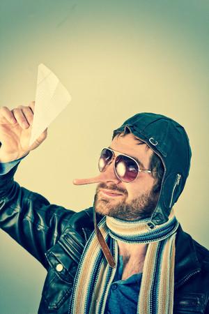 trickster: Aviator pilot with giant long liar nose Stock Photo