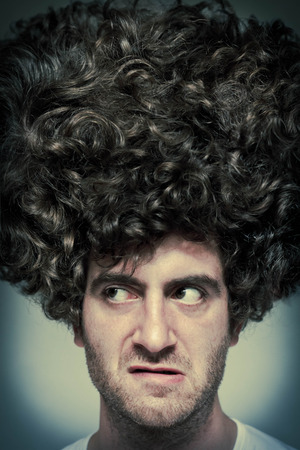 mouthing: Scruffy faced man with messy curly hair afro Stock Photo