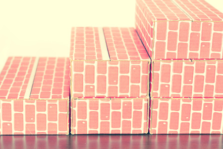 Cardboard brick column graph showing steady growth Stock Photo