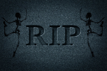 Engraved headstone spelling the letters RIP with Skeletons - rest in peace