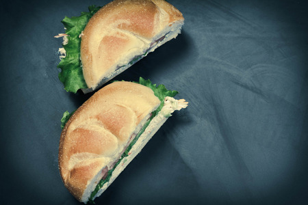 kaiser: Bound seafood salad sandwich with mayo on a kaiser roll