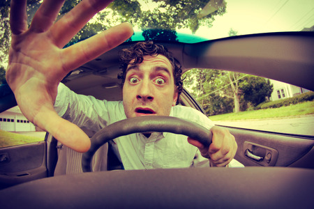 gets: Silly man gets into car crash and makes ridiculous face