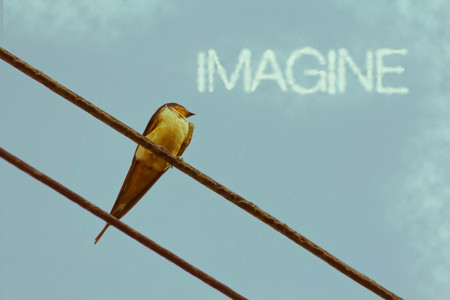 Inspiring sparrow on telephone wire - clouds say Imagine