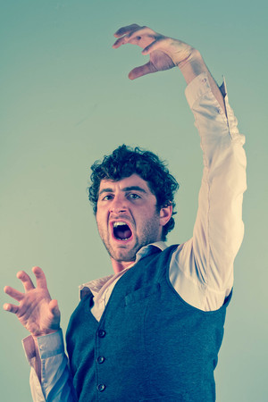 barbaric: Man acting like an animal by growling snarling and clawing Stock Photo
