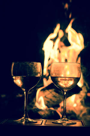 Two wineglasses by the campfire in this picturesque romantic scene Stock Photo