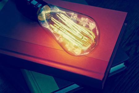 trapped: Horrifying vintage Halloween themed skeleton trapped inside lightbulb