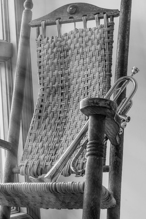 rocking chair: Old trumpet sits on a rocking chair in the early morning light