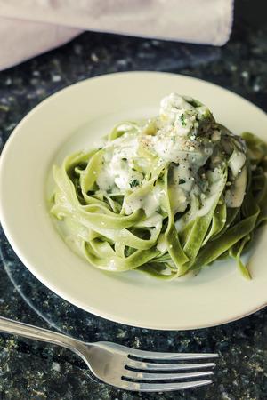 alfredo: Fancy organic spinach fetuccine pasta with creamy alfredo sauce Stock Photo