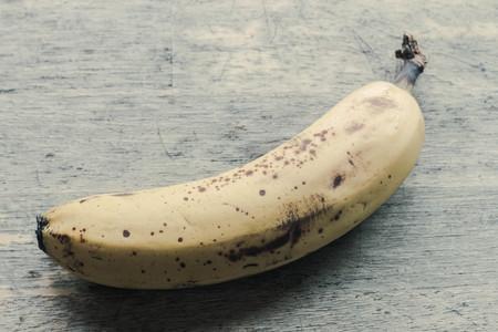 bad banana: Spotted brown banana ready for baking banana bread Stock Photo