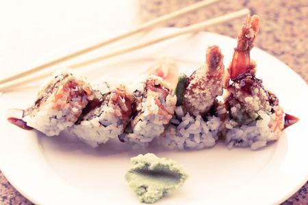 Shrimp tempura avocado sushi roll with sweet sushi sauce Stock Photo - 48927437