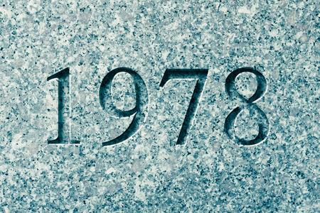Historical year engraving 1978 on textured old surface