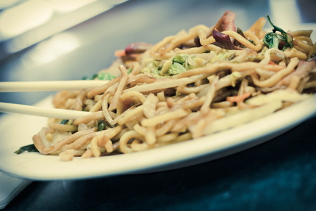 mee pok: Eating Chinese pork lo mein noodles with chopsticks