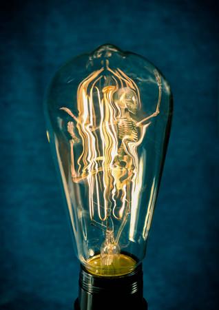 horrifying: Horrifying vintage Halloween themed skeleton trapped inside lightbulb