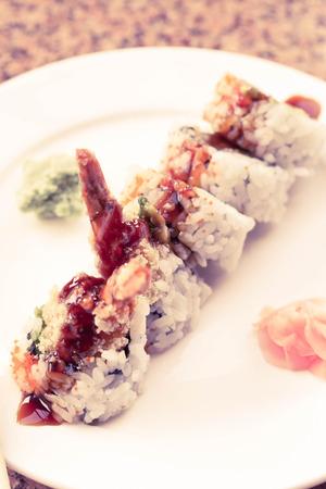 Shrimp tempura avocado sushi roll with sweet sushi sauce Stock Photo - 48916916
