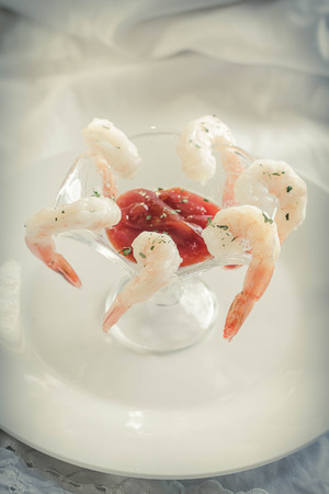shrimp cocktail: Delightful tail-on shrimp cocktail served with savory horseradish sauce Stock Photo