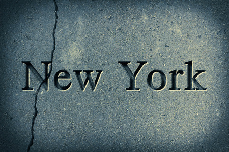 old new york: Engraving spelling the city New York on textured old surface