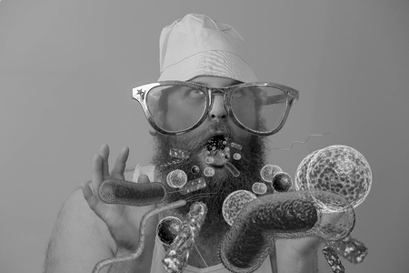 spew: Bacteria virus sickness pouring out sick bearded mans open mouth Stock Photo